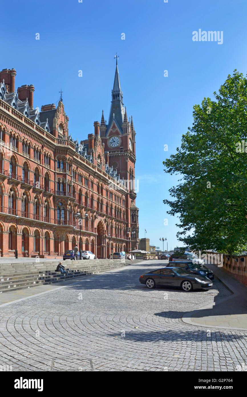 Victorian St Pancras International railway station façade & clock tower & St Pancras Renaissance Hotel - Stock Image