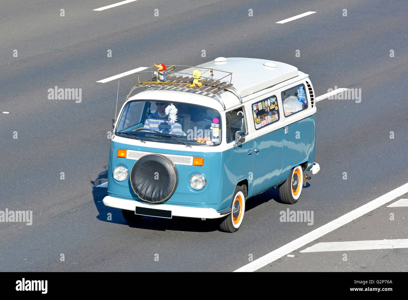 Classic VW Volkswagen camper van driving along English UK motorway obscured numberplate - Stock Image