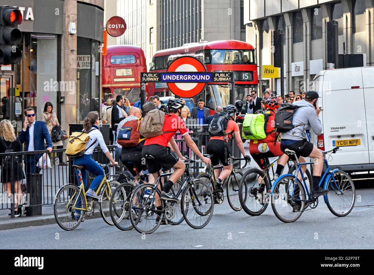 Evening rush hour in City of London England UK as workers cycle home cyclists competing with other commuters and - Stock Image