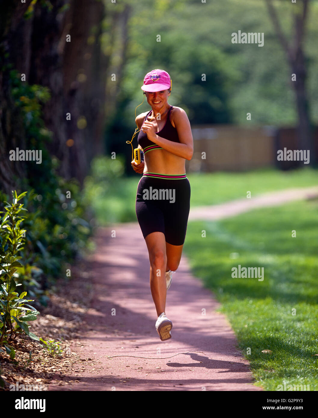 A girl running, outdoors. - Stock Image