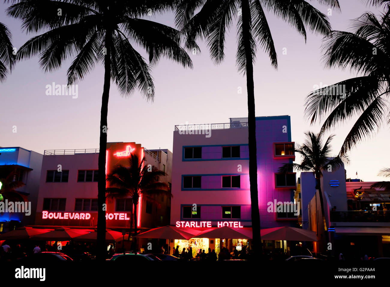 Art deco hotels at night with neon lights along Ocean Drive in the Art Deco District of South Beach Miami Florida - Stock Image