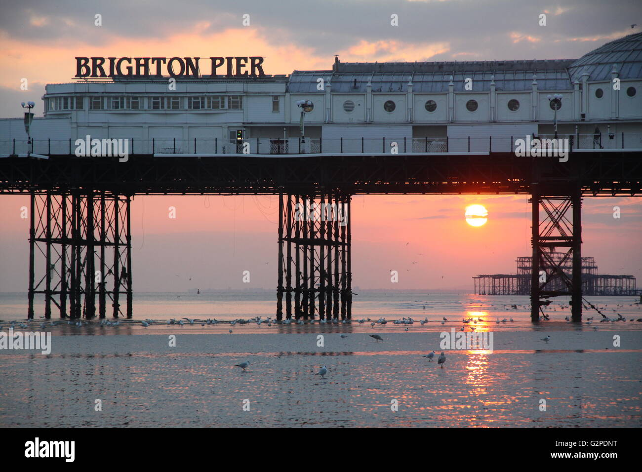 Brighton Pier and Beach with a nice sunset - Stock Image