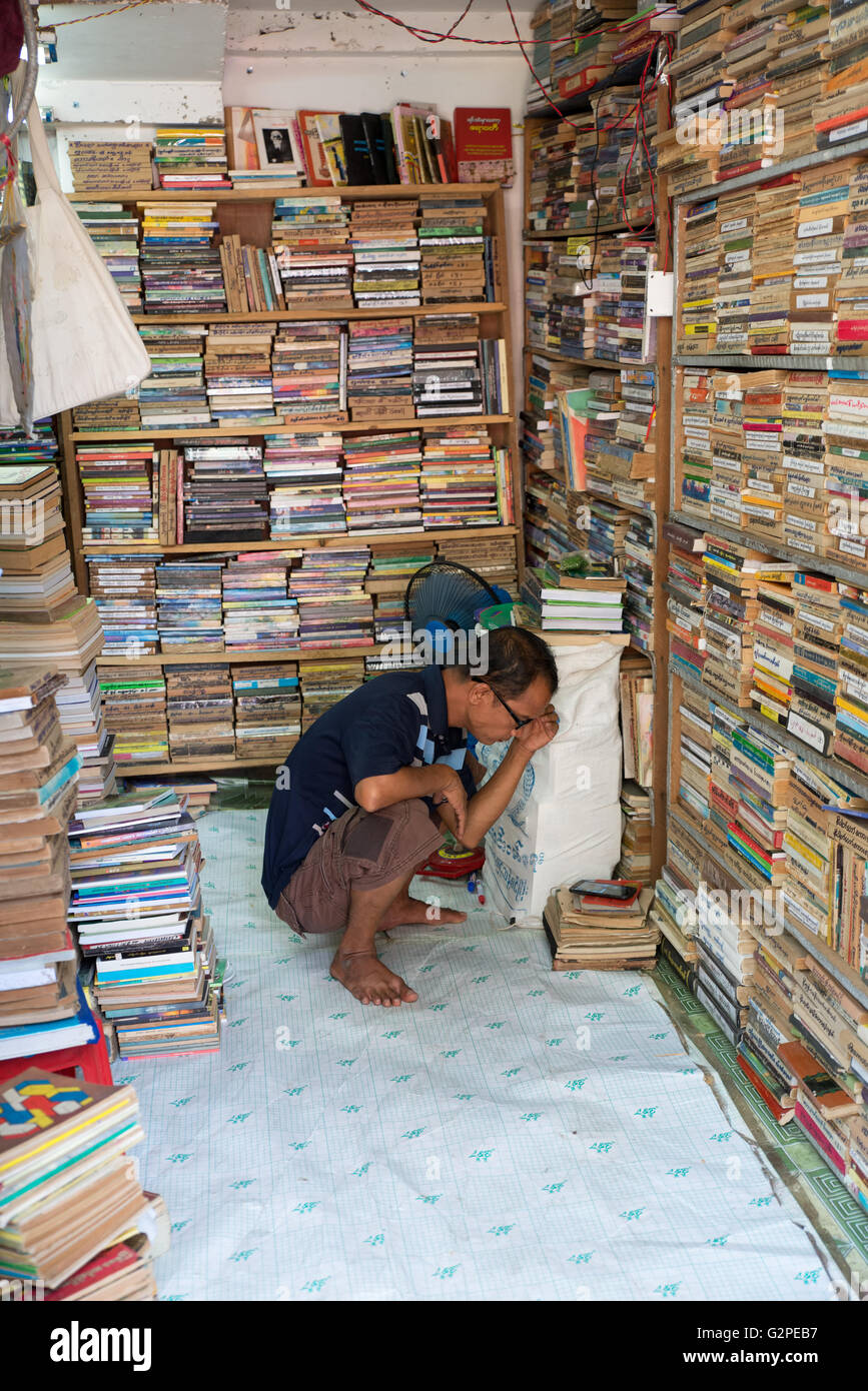 Secondhand bookseller on the street, Yangon, Yangon State, Myanmar - Stock Image
