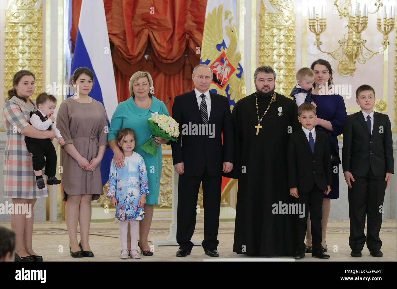 Moscow, Russia. 01st June, 2016. Russia's president Vladimir Putin (C) presents the Order of Parental Glory - Stock Image