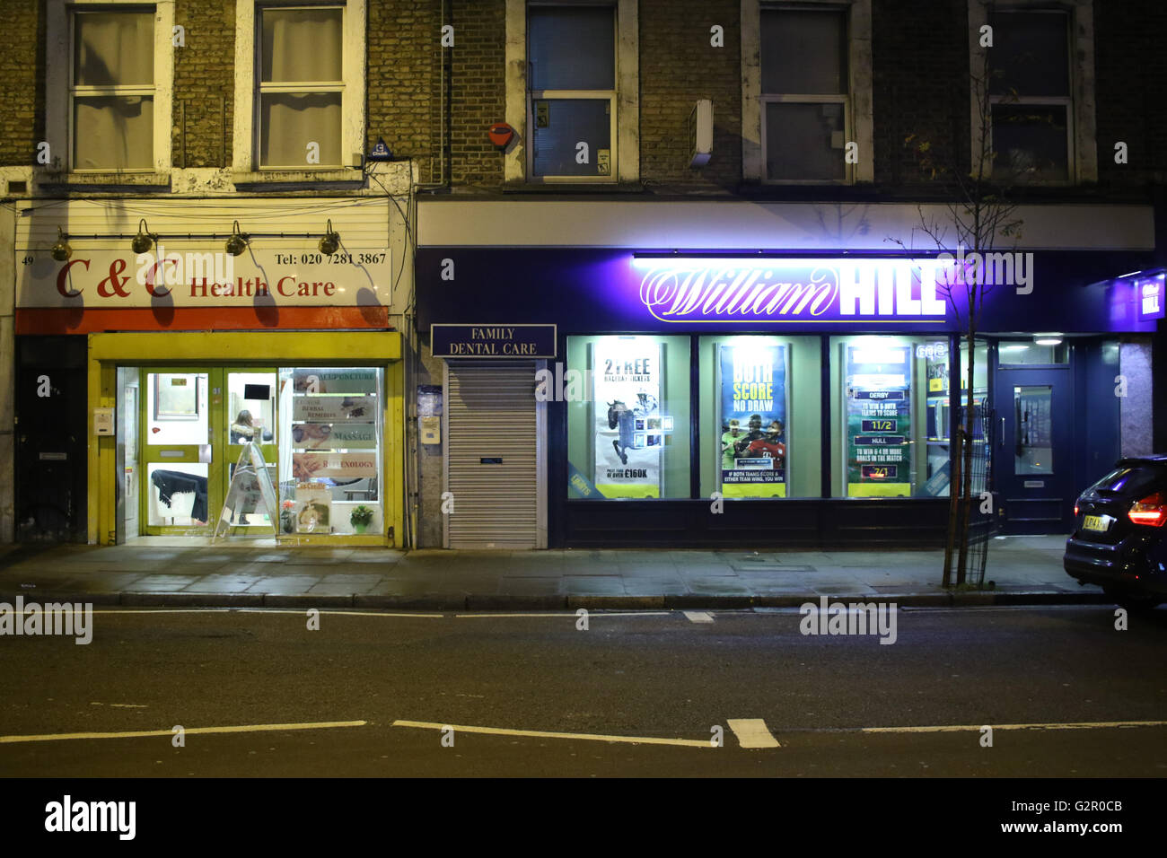 Shop frontages of a health care center and Willam Hill bookmakers - Stock Image