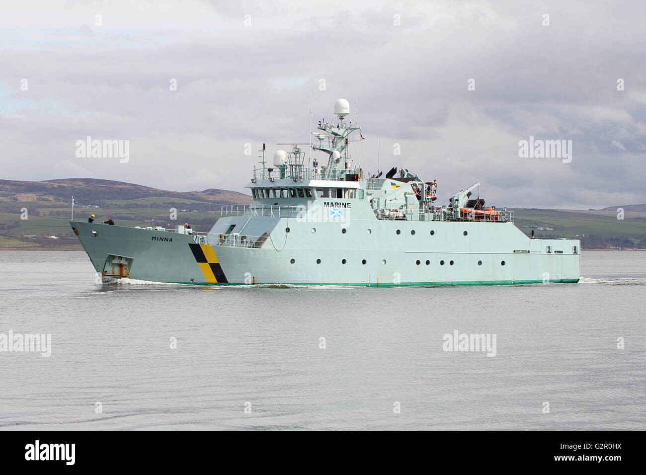 MPV Minna of Marine Scotland (formerly the Scottish Fisheries Protection Agency), heads out from Greenock on another - Stock Image
