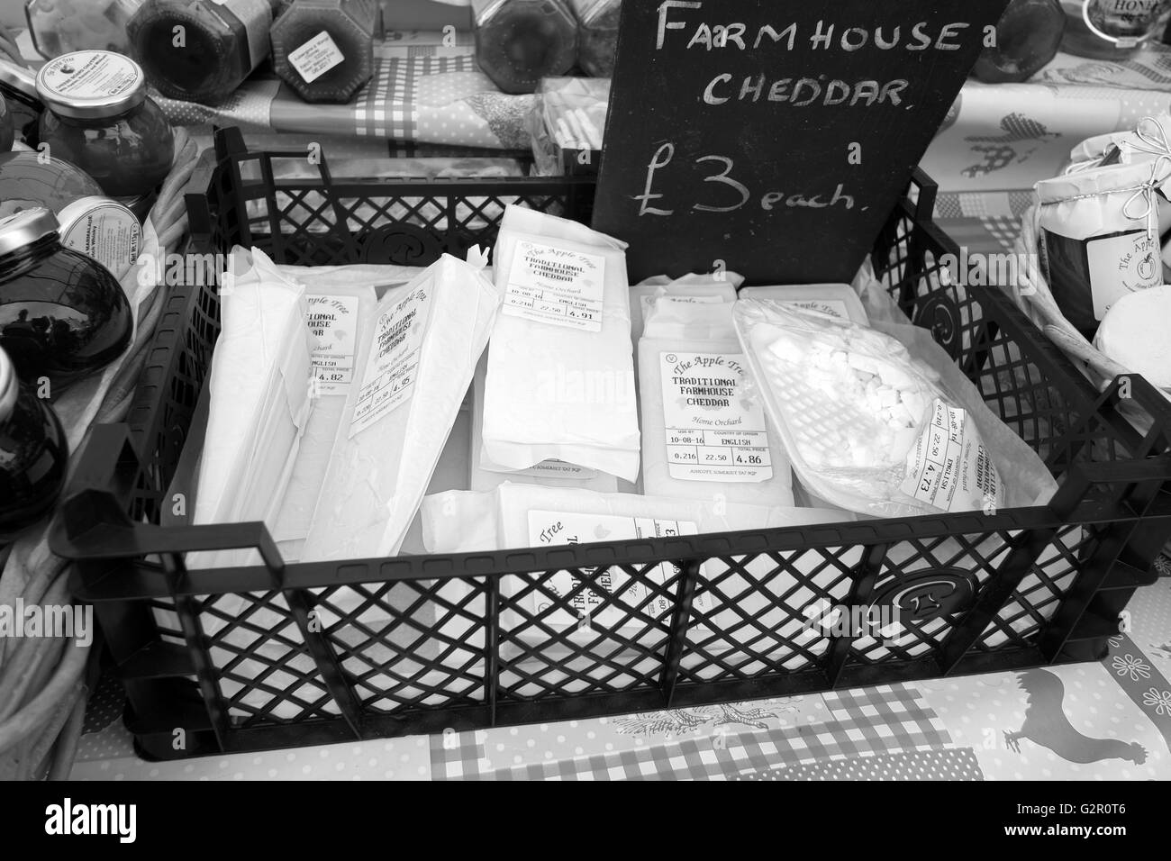 Farmhouse Cheddar cheeses and pickles for sale in Wells market. May 2016 - Stock Image