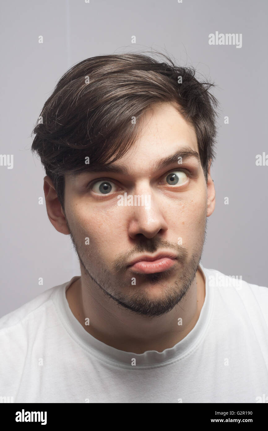 Young man portrait, face with skew eyed, cross eyed, skew eyed. - Stock Image