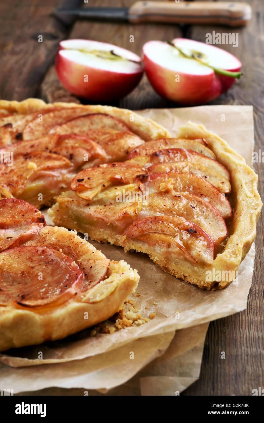 Sliced apple pie on paper, fruit baking - Stock Image