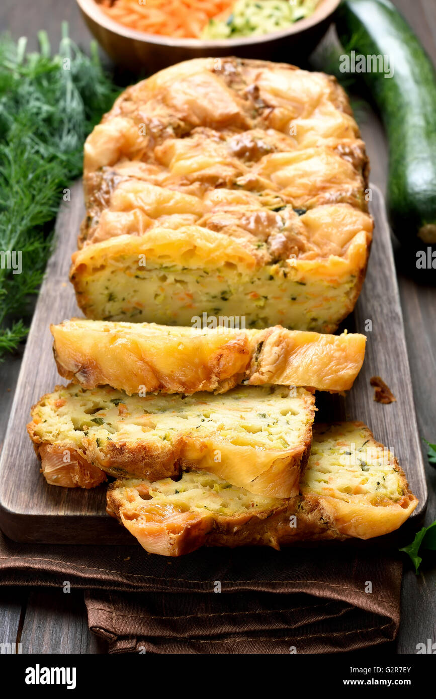 Sliced vegetable moist bread with zucchini, carrot, cheese, eggs - Stock Image