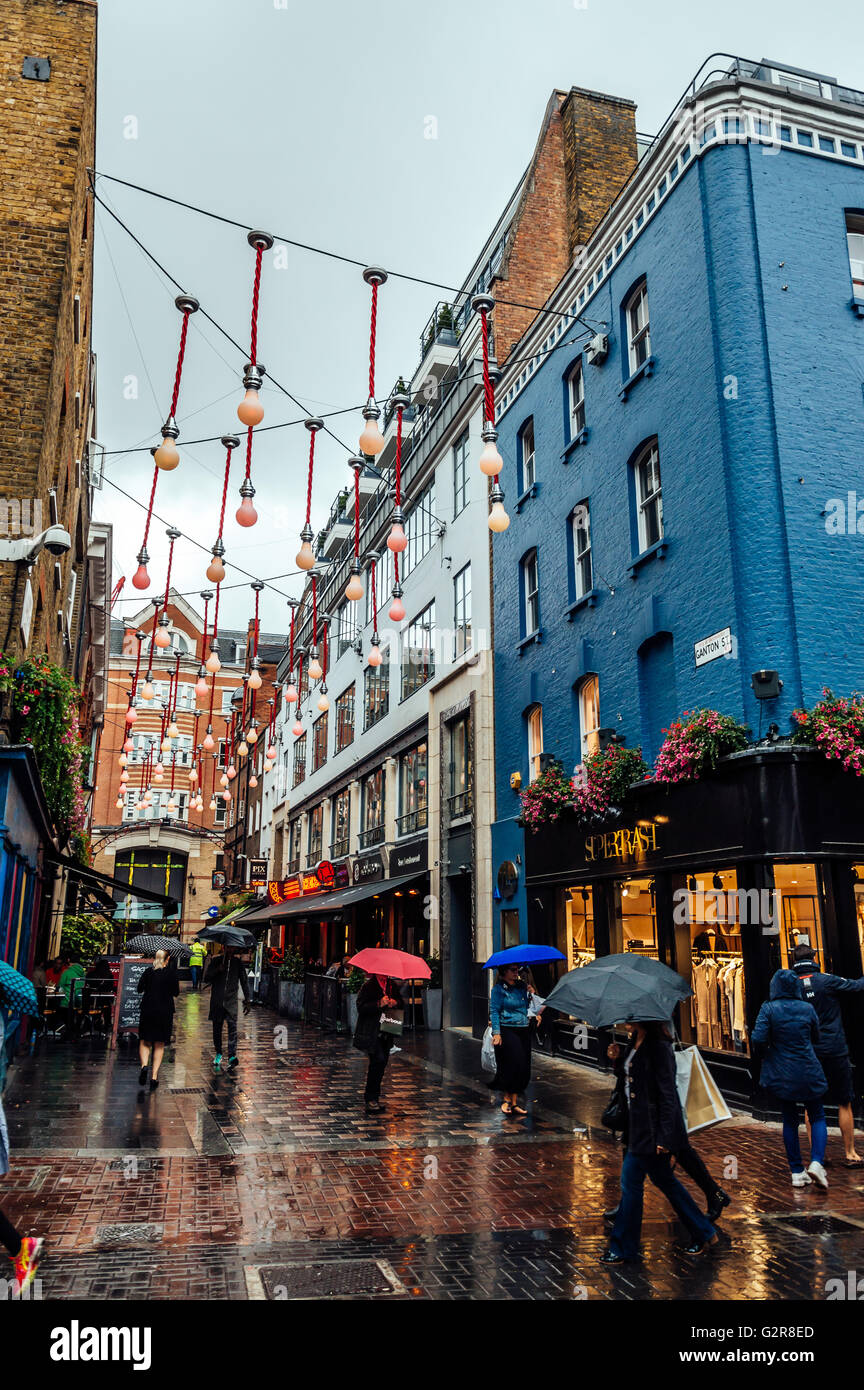 LONDON, UK - AUGUST 24, 2015: View of Carnaby Street. Carnaby Street is a pedestrianised shopping street in Soho - Stock Image