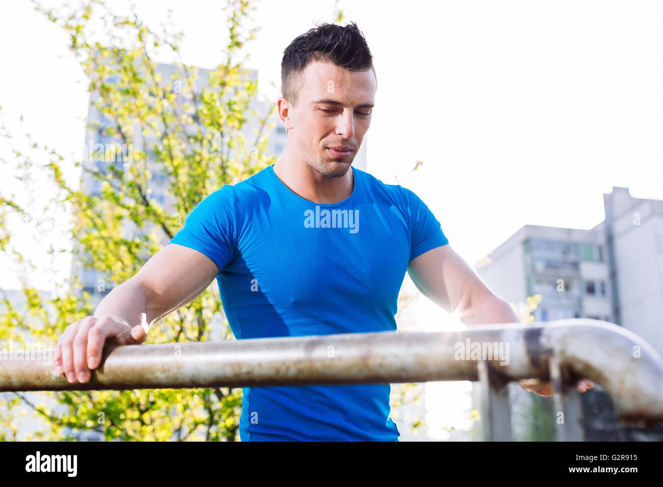 Street workout, confident sportsman Stock Photo