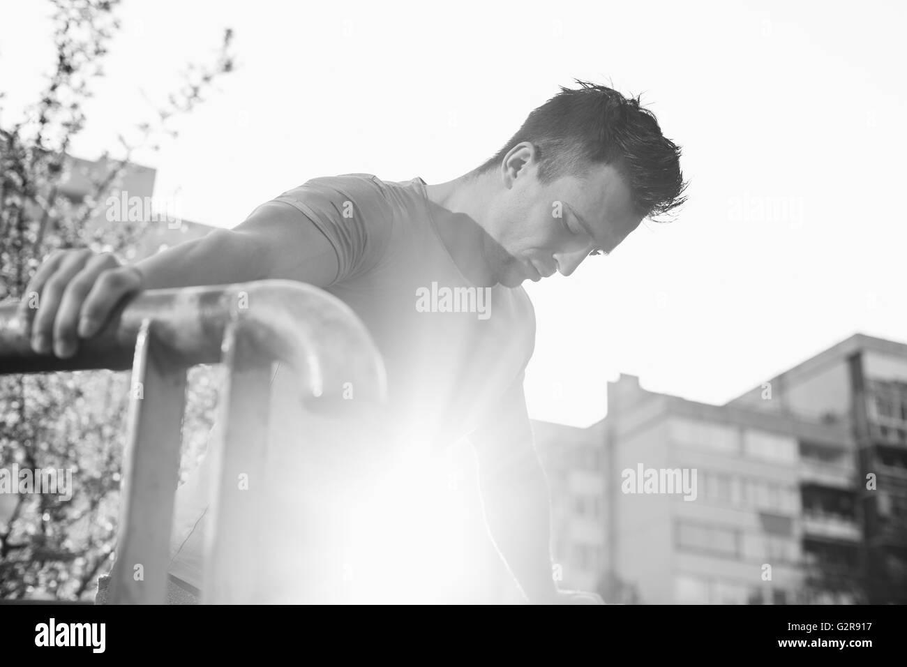 Street workout, confident sportsman - Stock Image