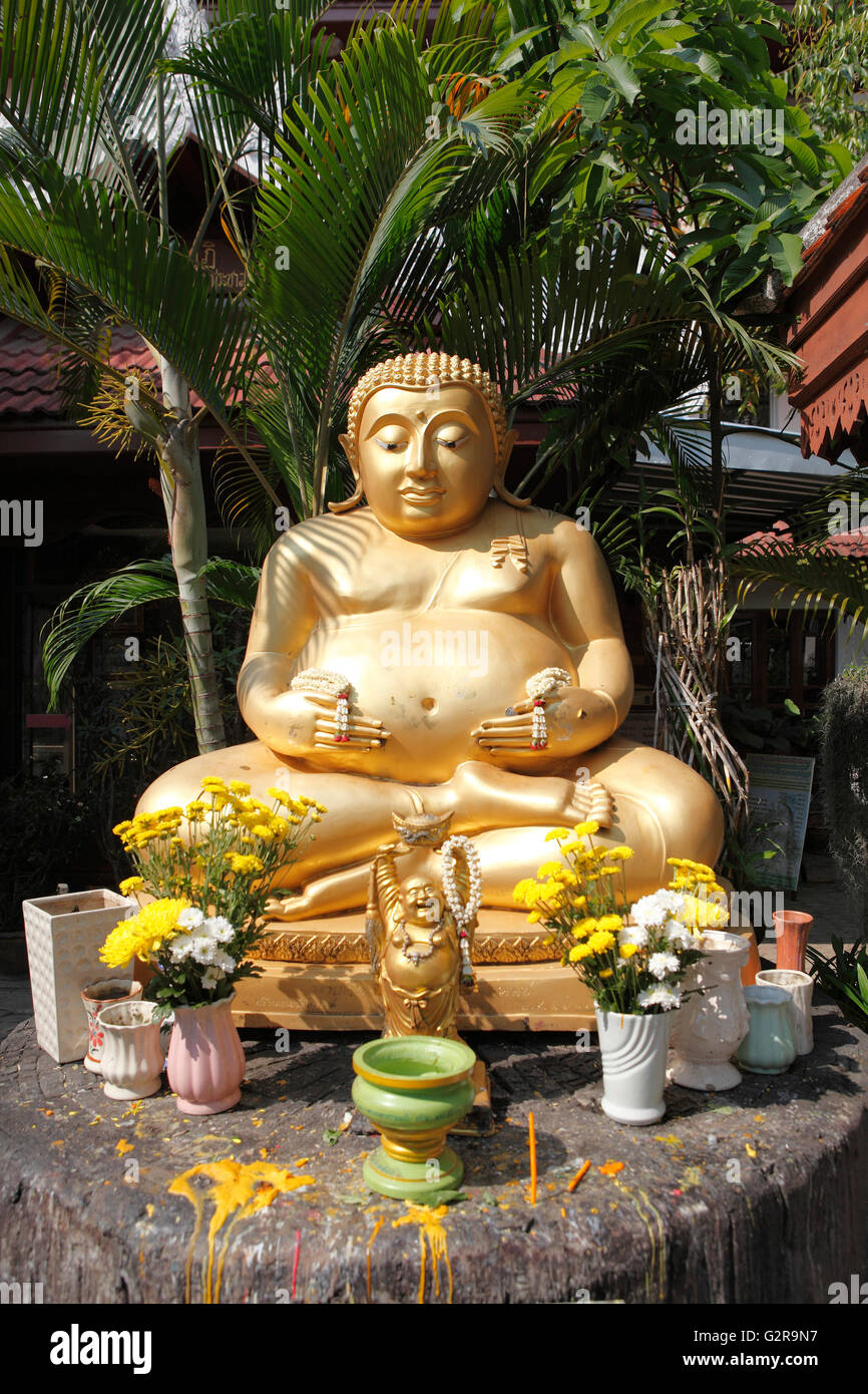 Golden Buddha statue in the garden of the Wat Phra Singha temple, Chiang Rai, Thailand, Asia Stock Photo