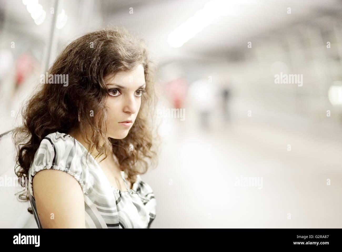 Young woman in a public space, Allgaeu, Kempten, Allgäu, Swabia, Bavaria, Germany - Stock Image