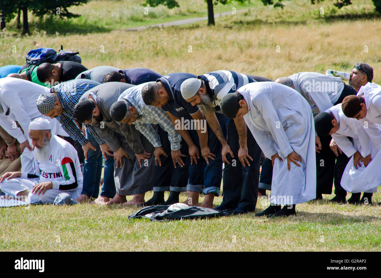 Muslims Praying in Hyde Park Following a March Through London - Stock Image