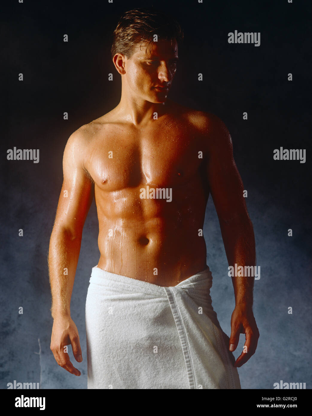 Guy in a towel - Stock Image