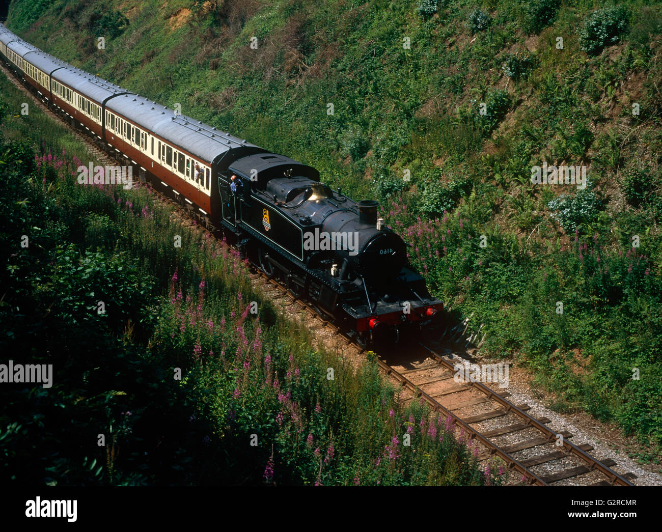 Steam train on the railway, outside. - Stock Image
