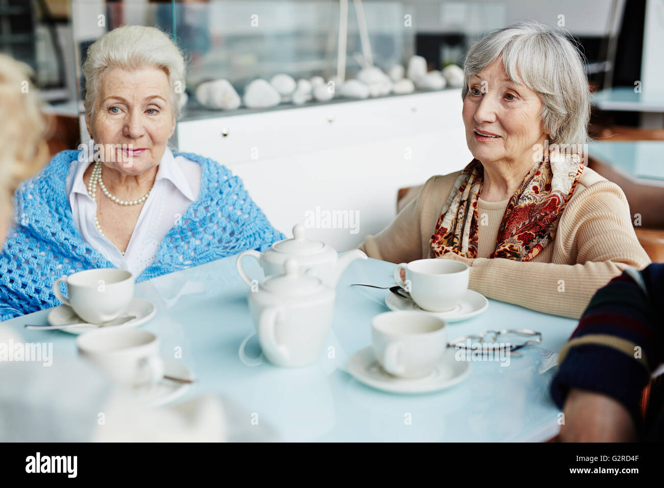 Group of seniors having nice time in cafe - Stock Image