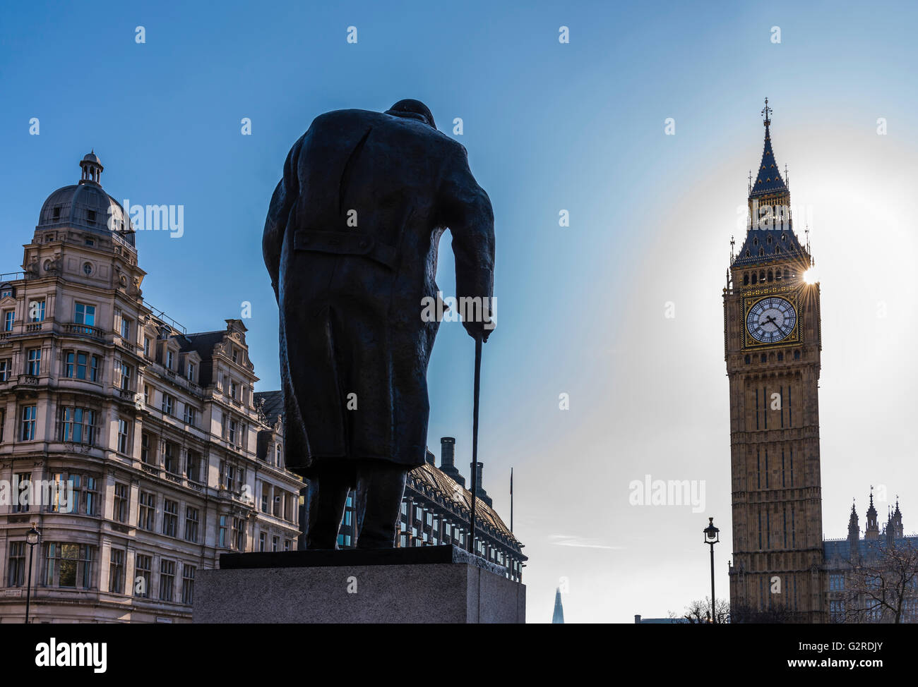 Sun shining next to Big Ben and Parliament Square, Westminster, London, UK. - Stock Image