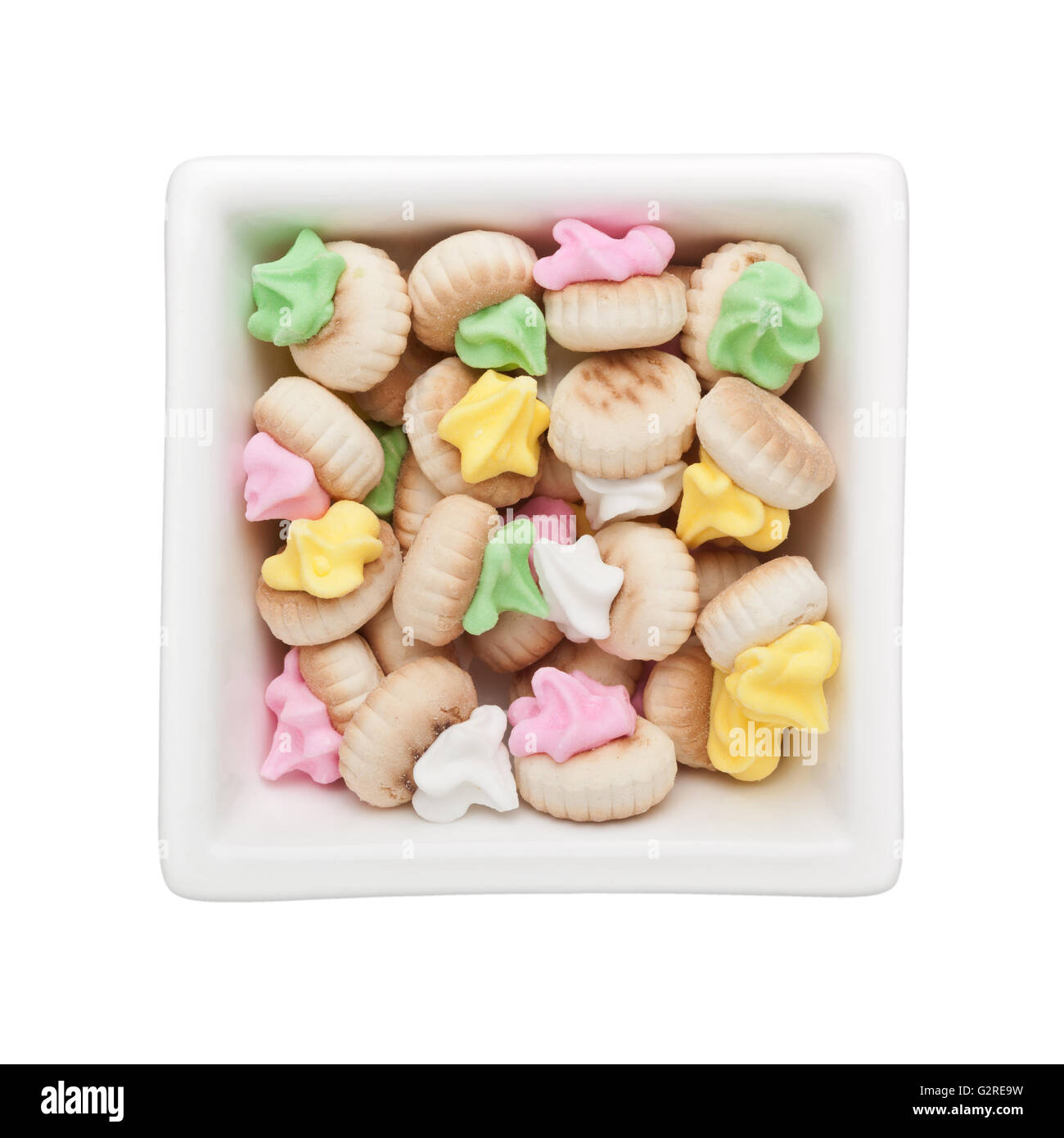 Iced gem biscuits in a square bowl isolated on white background - Stock Image
