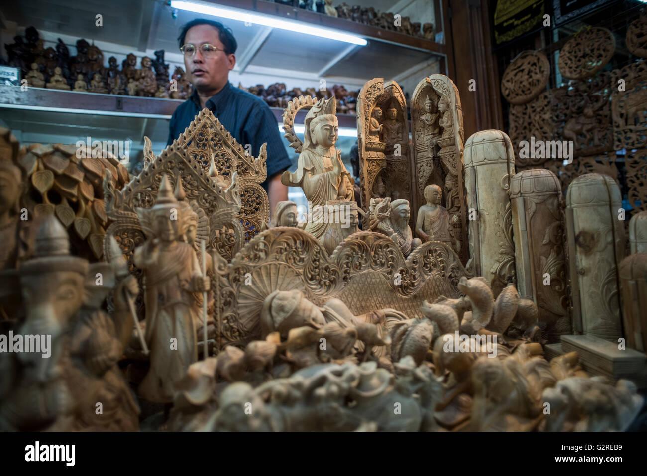 Souvenirs vendor wood carvings stock photos