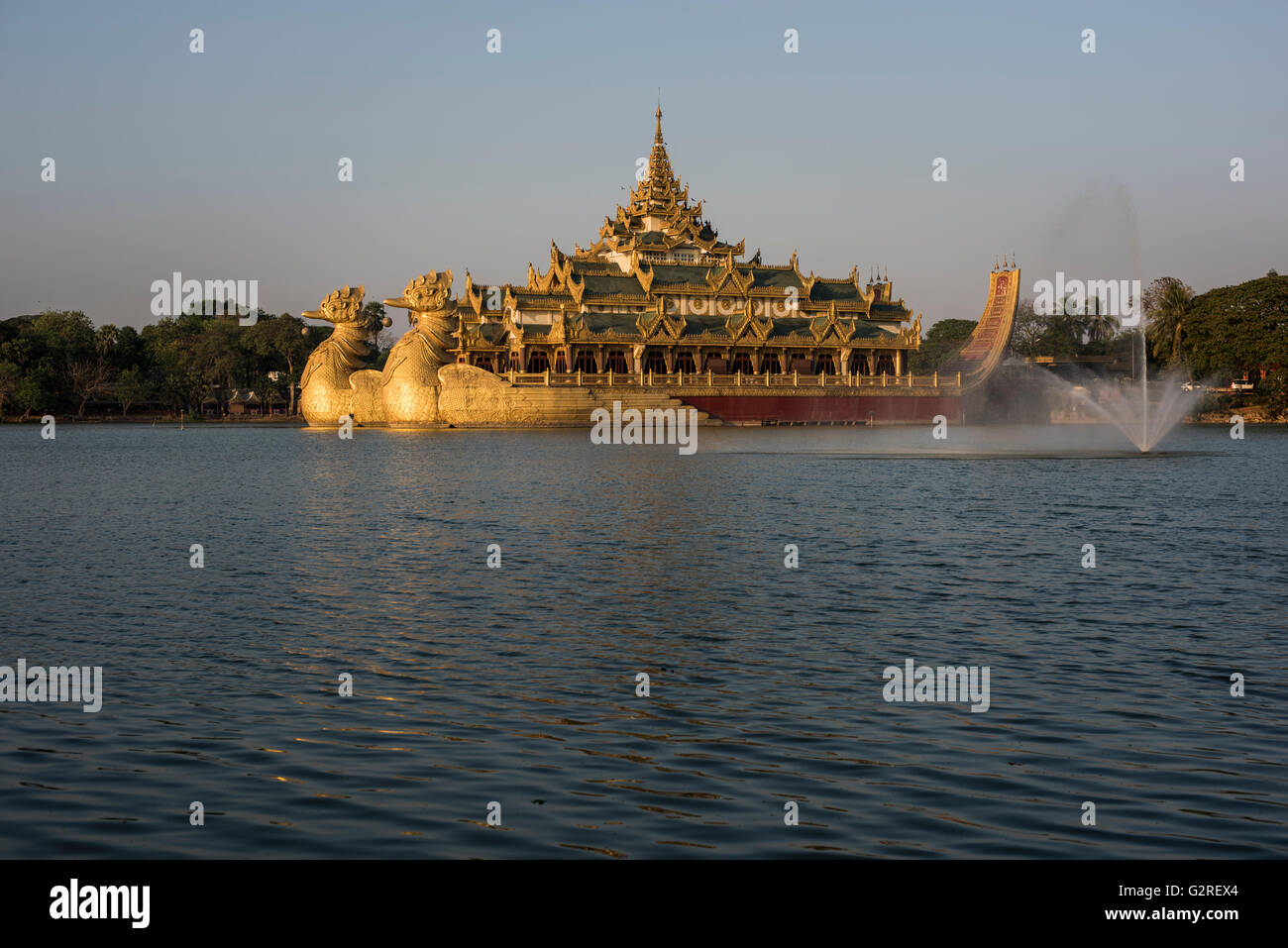Karaweik Hall floating restaurant at the Kandawgyi Lake, Yangon, Myanmar. Stock Photo