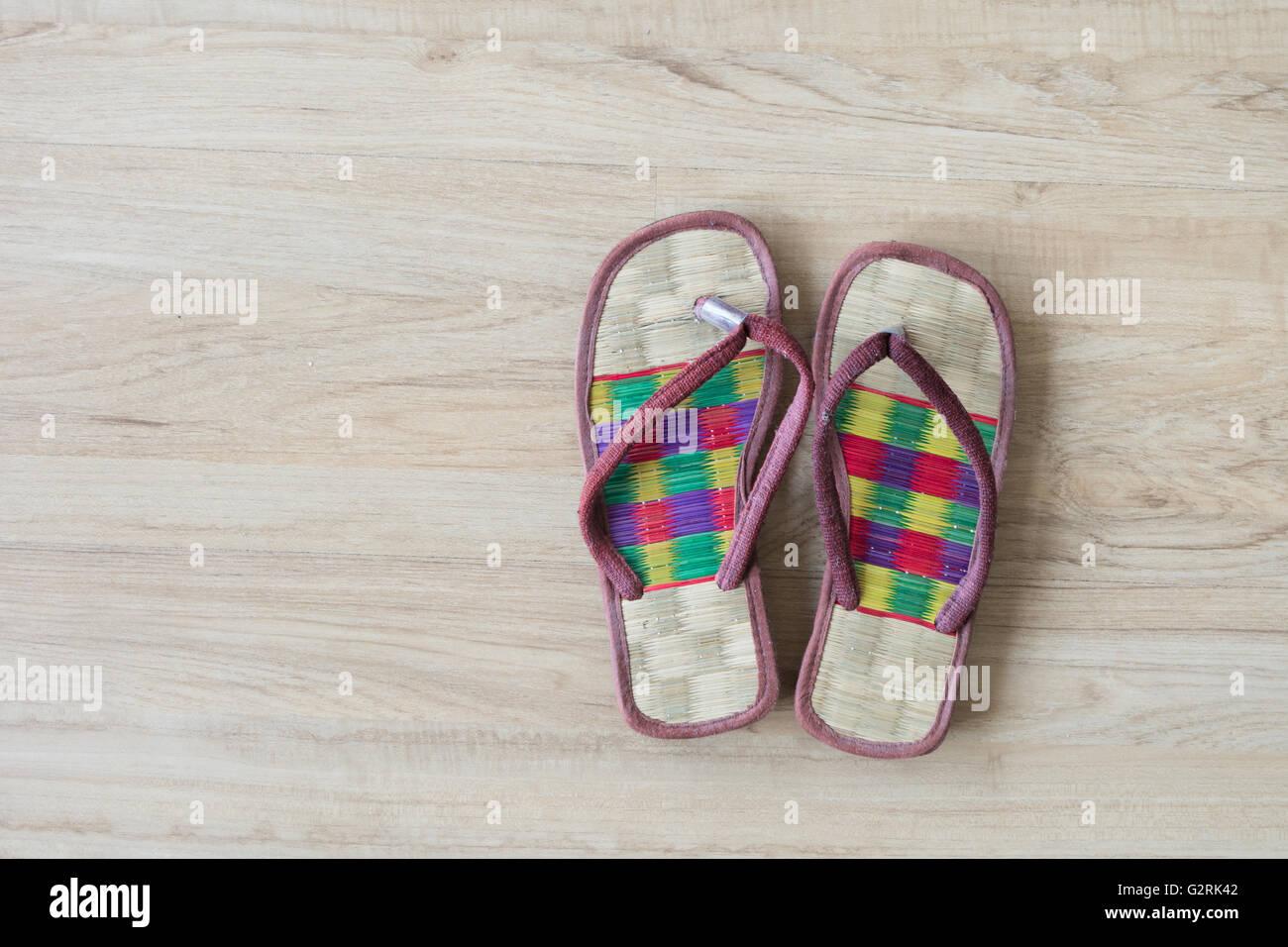 spa cozy weave sandal on wooden floor. - Stock Image