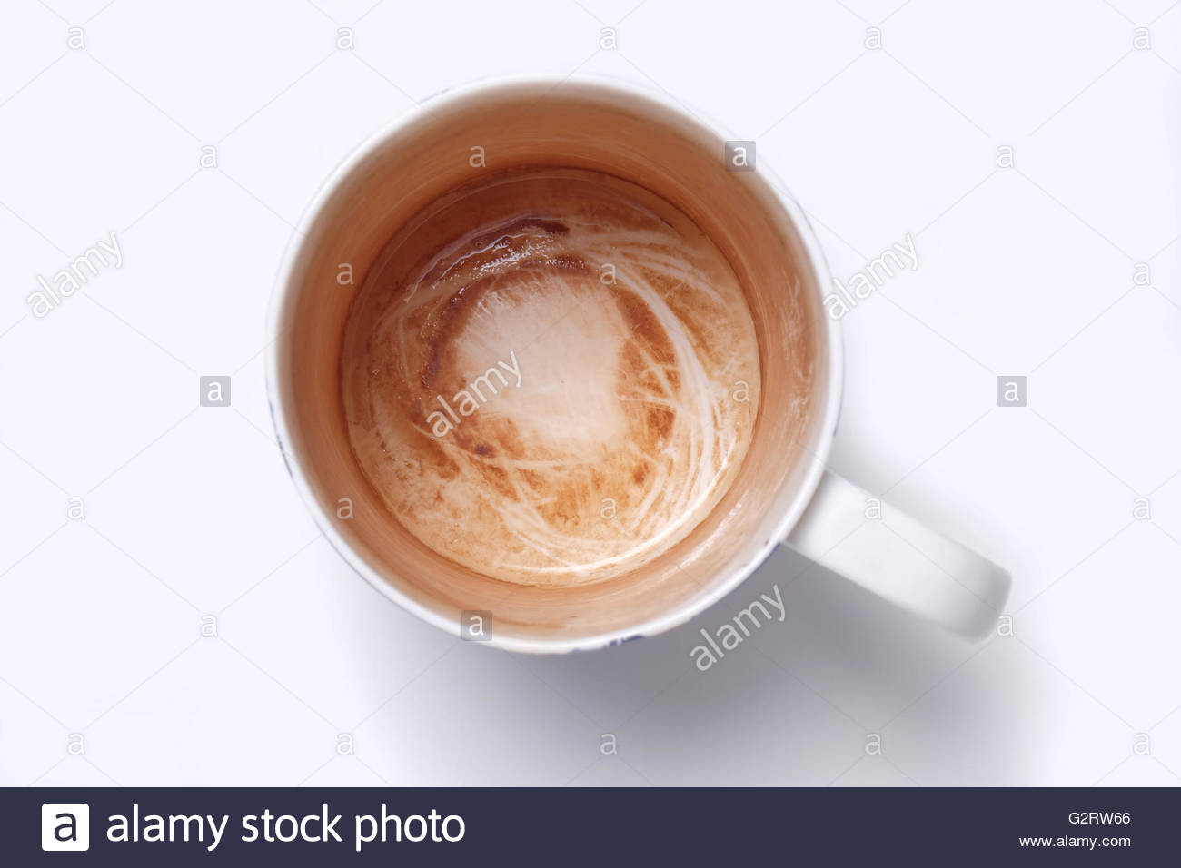 overhead shot of mug with tea stains left inside - Stock Image