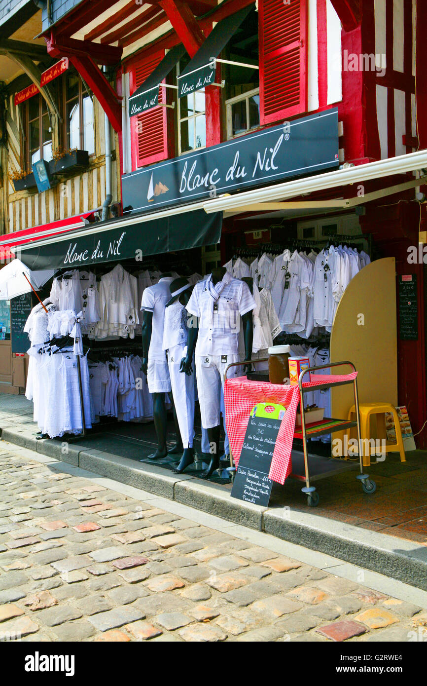 Traditional white clothing sold in a store in the harbor of Honfleur, Normandy, France - Stock Image