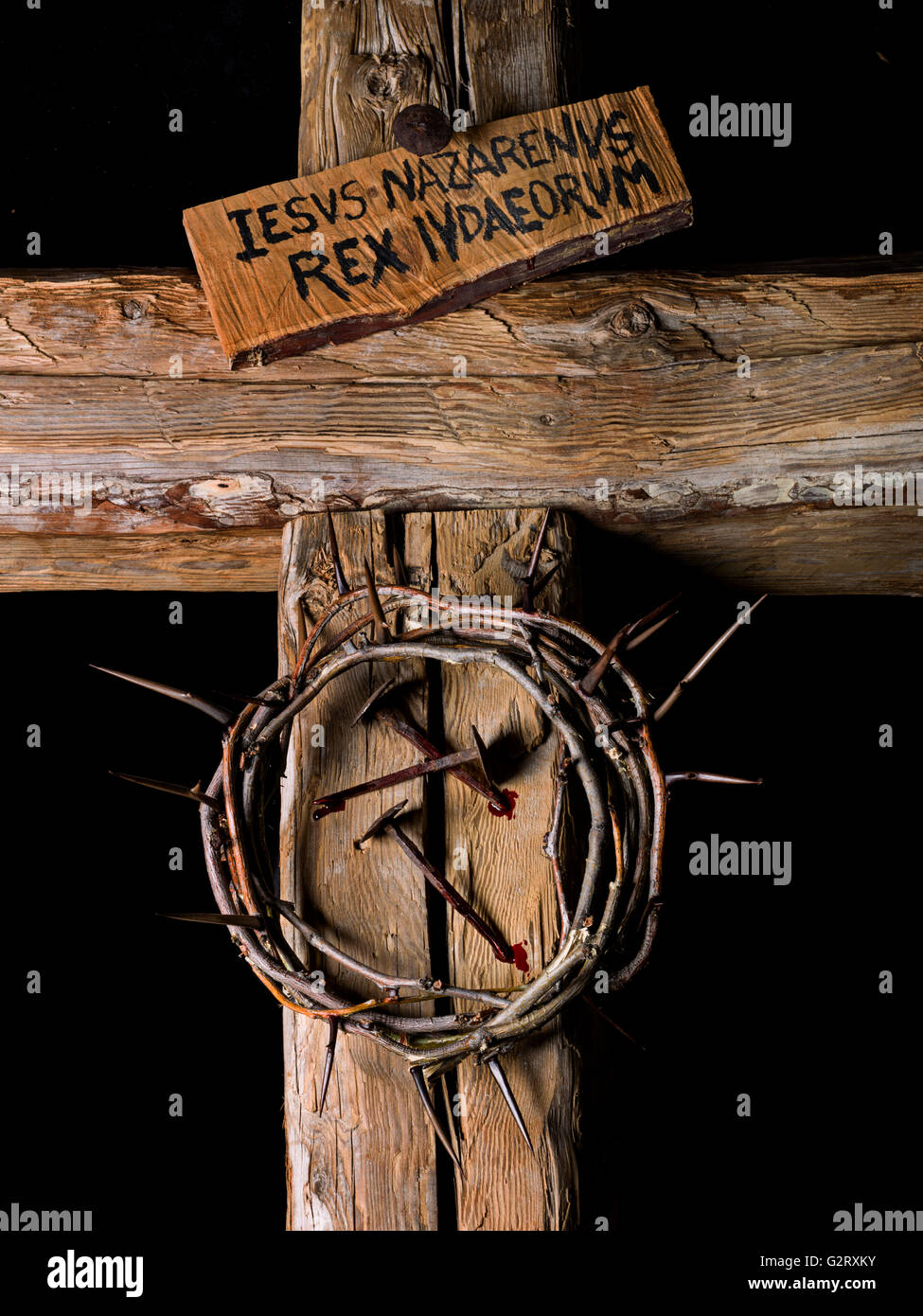Crown Of Thorns And Nails Of Christ With Blood On Wooden