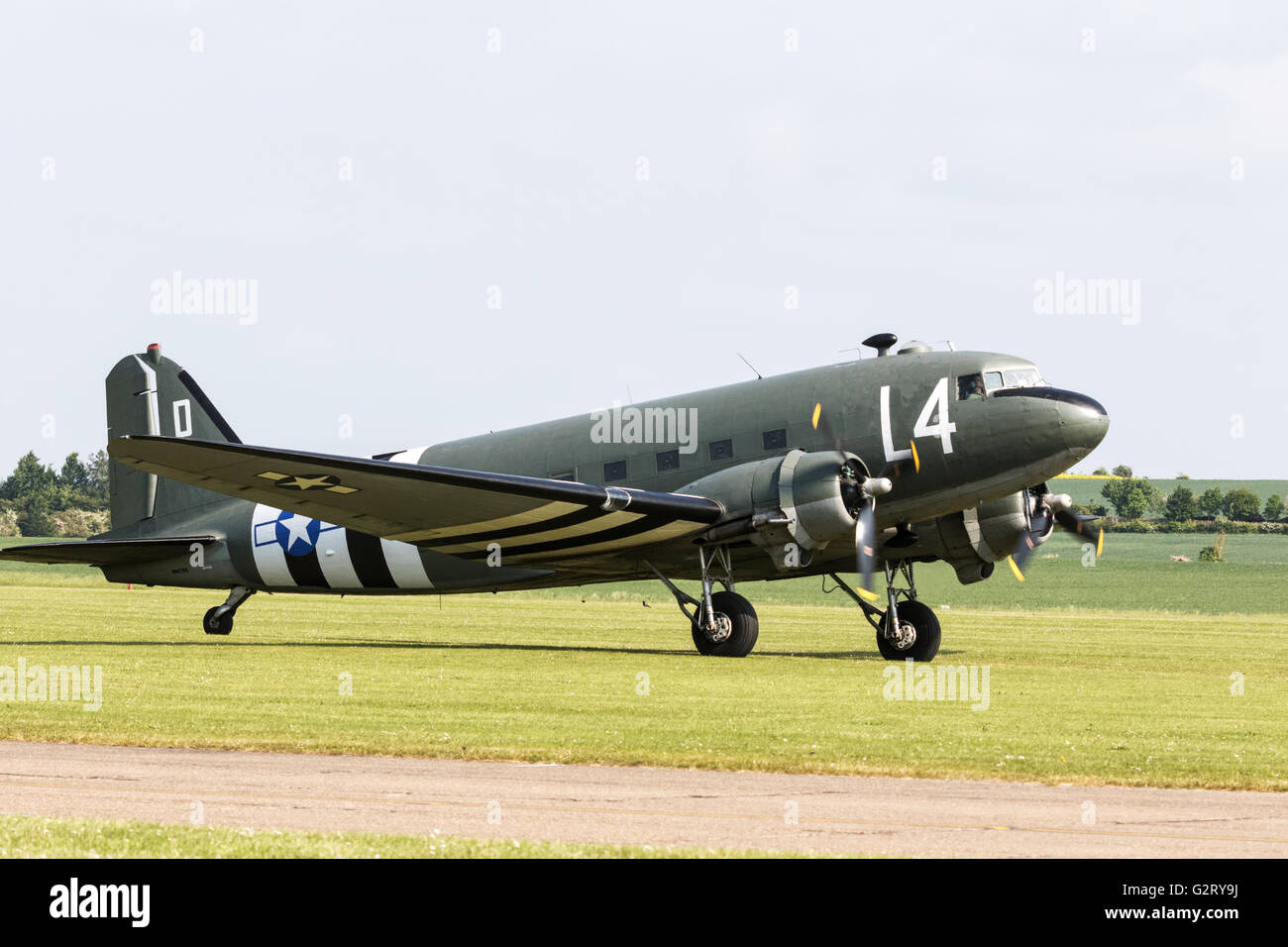 A Douglas C-47A Skytrain airplane taxiing, Duxford Imperial War Museum Airport, Cambridge UK - Stock Image