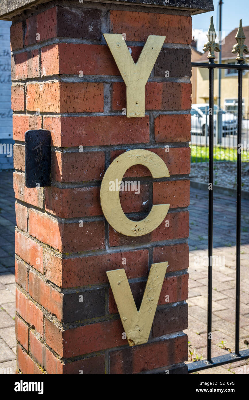 YCV lettering attached to UVF mural and memorial garden in the loyalist Cregagh estate in East Belfast, Northern Stock Photo