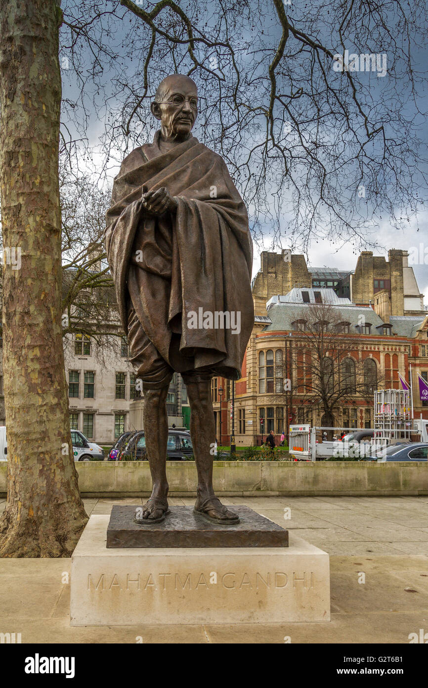 The bronze statue of Mahatma Gandhi by the sculptor Philip Jackson in Parliament Square,Westminster ,London, United - Stock Image