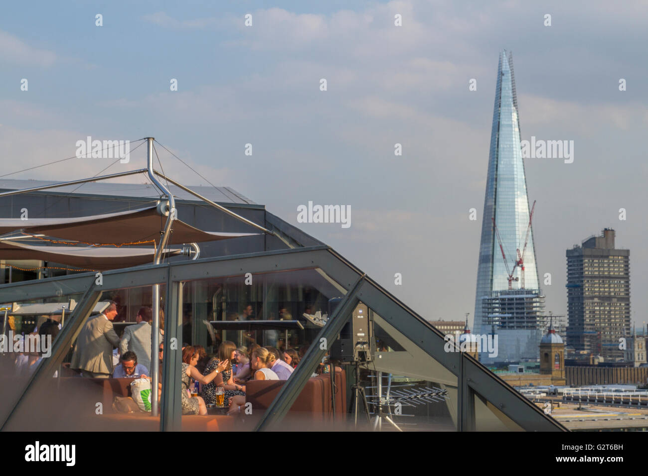 Diners At  A City Restaurant on the roof of One New Change, With The Shard in The Distance - Stock Image