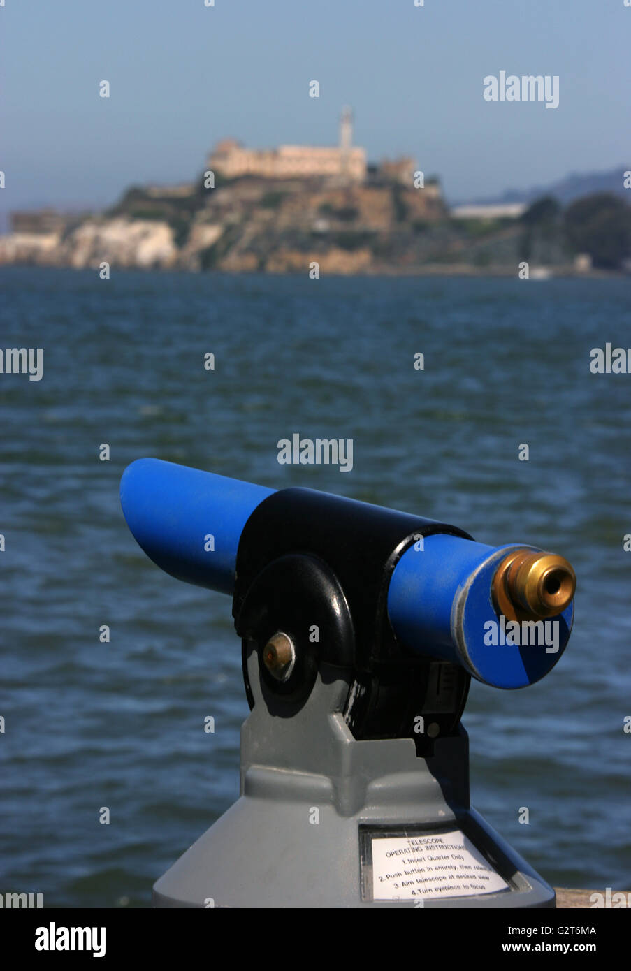 A view-scope telescope pointed at Alcatraz Island in San Francisco Bay California. - Stock Image