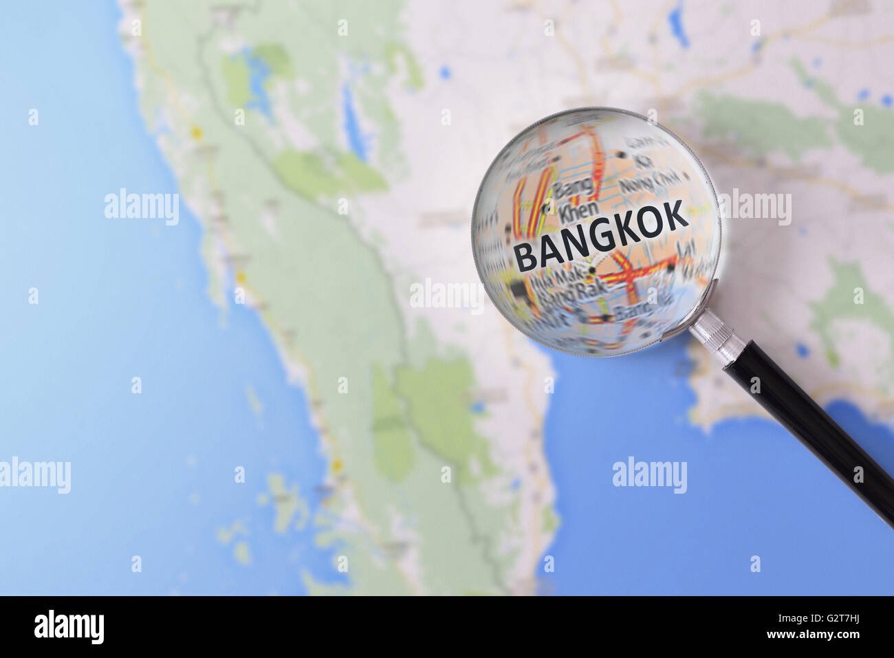 Map of Bangkok consulted with a magnifying