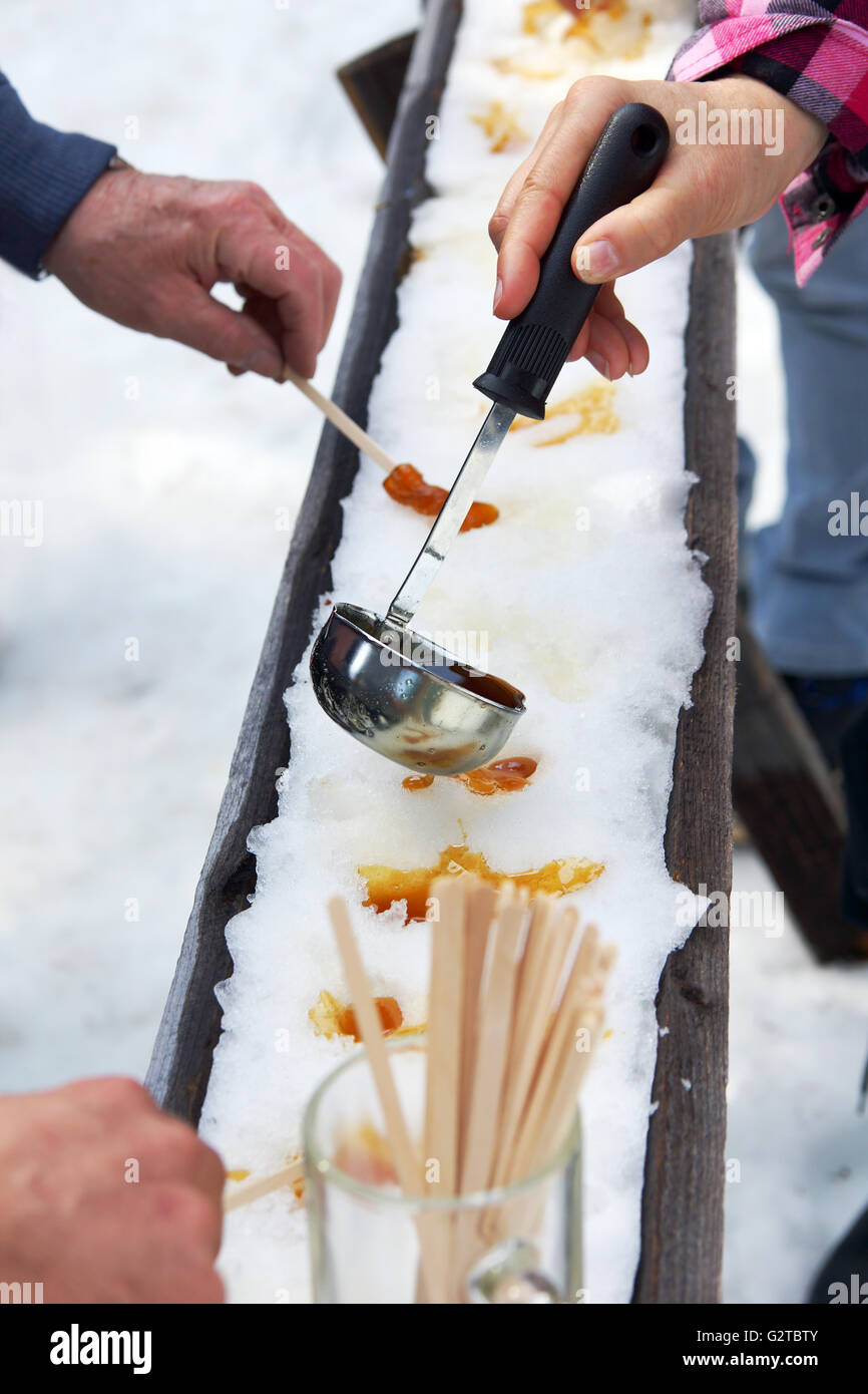 Sugar on snow, or maple toffee at the sugar shack in Quebec