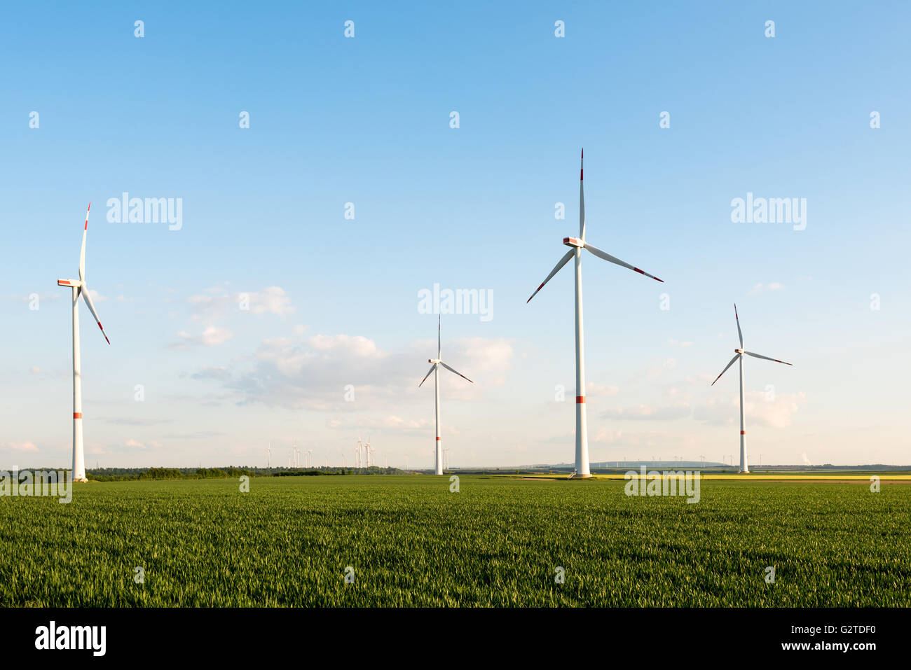 Wind turbines in front of a coal-fired plant - Stock Image