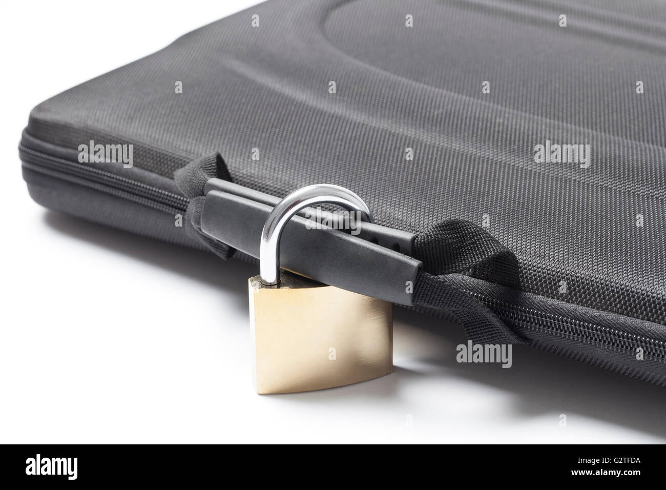 Closed and locked with a metal padlock black briefcase isolated on white background. - Stock Image