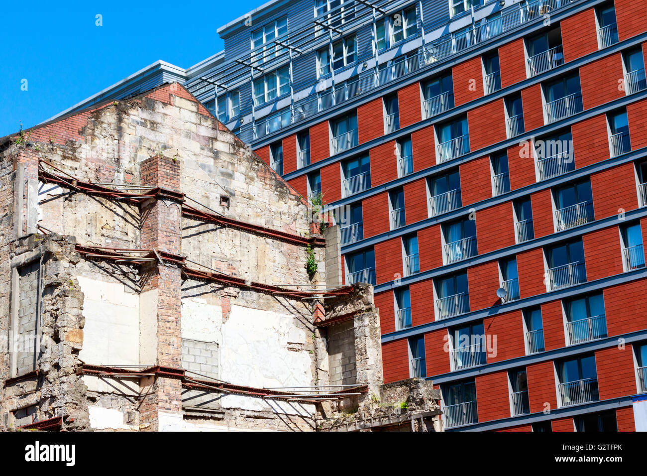 New build flats and apartments in the background of old styled building partially demolished, Glasgow, Scotland, - Stock Image