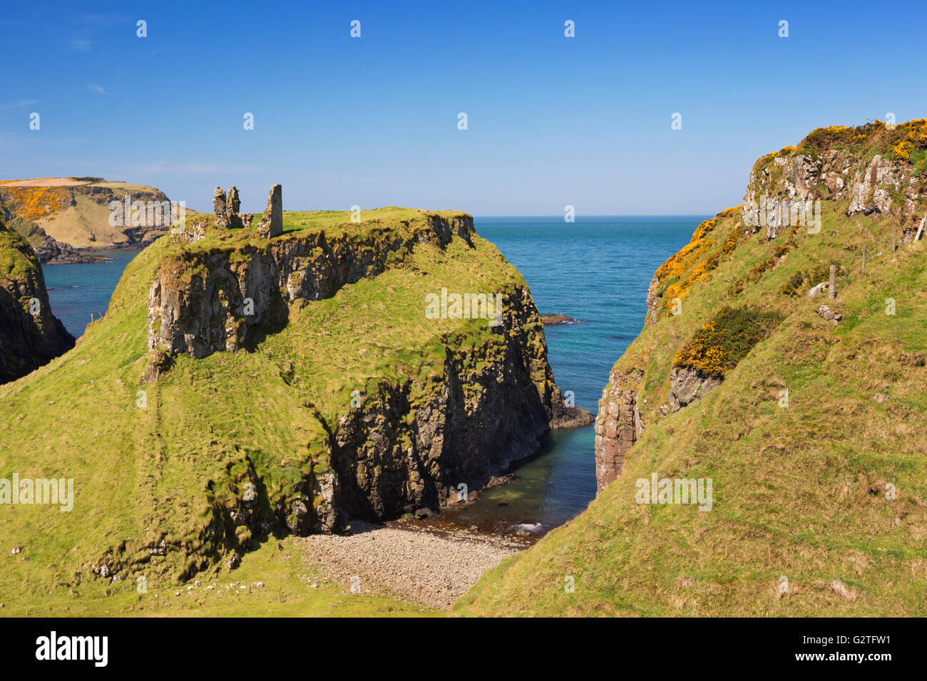 Cliffs with the ruins of Dunseverick Castle along the Causeway Coastal Way on the coast of Northern Ireland. Photographed - Stock Image