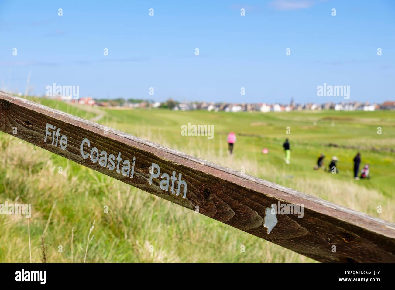 The Fife Coastal Path direction arrow on fence by Earlsferry Links golf course. Elie and Earlsferry East Neuk Fife - Stock Image