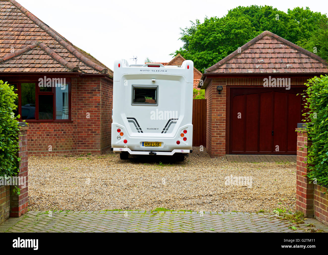 Motorhome parked in house driveway, England UK - Stock Image