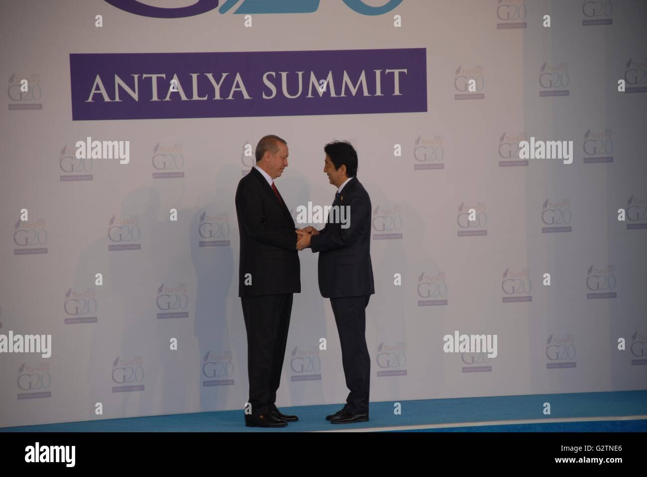 Japan's Prime Minister Shinzo Abe (R) is greeted by Turkish President Recep Tayyip Erdogan, during the G20 Turkey - Stock Image