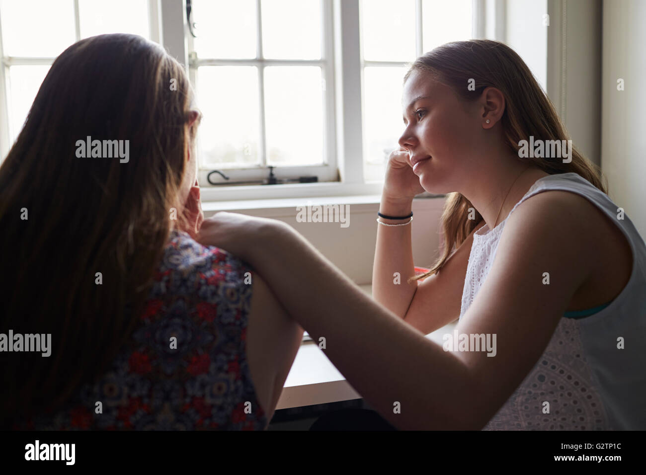 Teenage Girl Comforting Friend Suffering With Depression - Stock Image