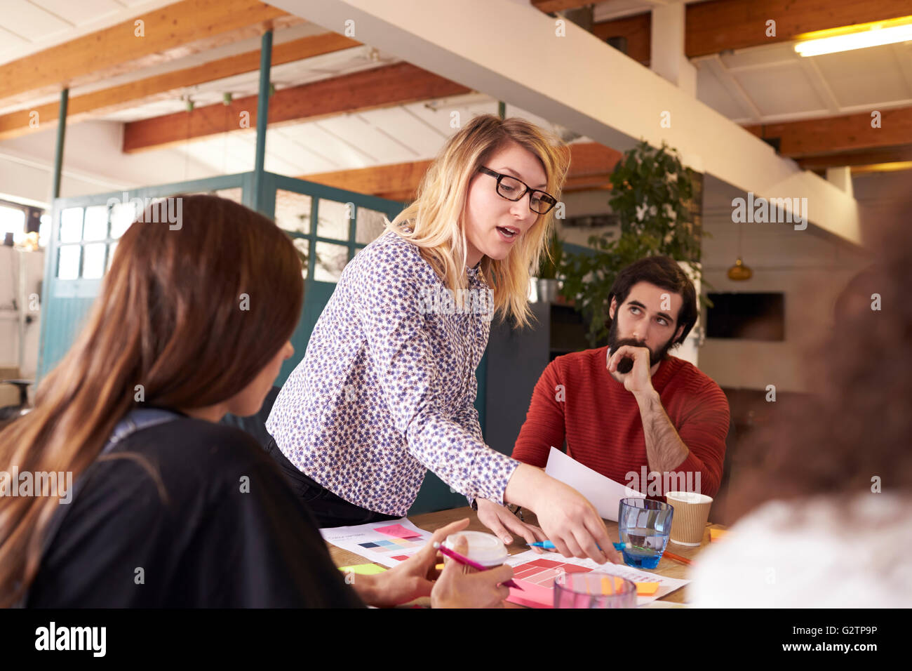 Female Manager Leads Brainstorming Meeting In Design Office - Stock Image