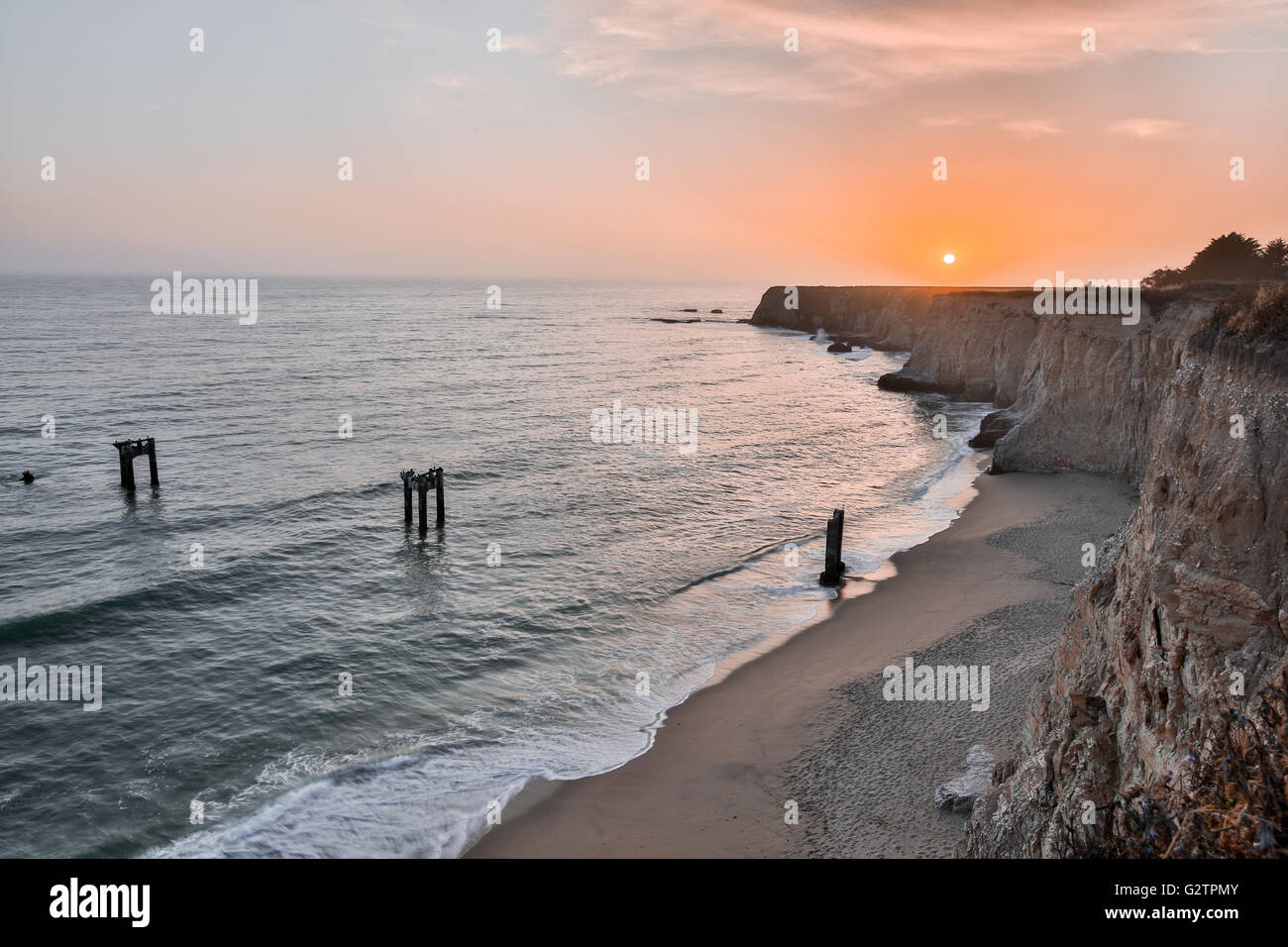 Sunset over Davenport Pier Beach - Stock Image