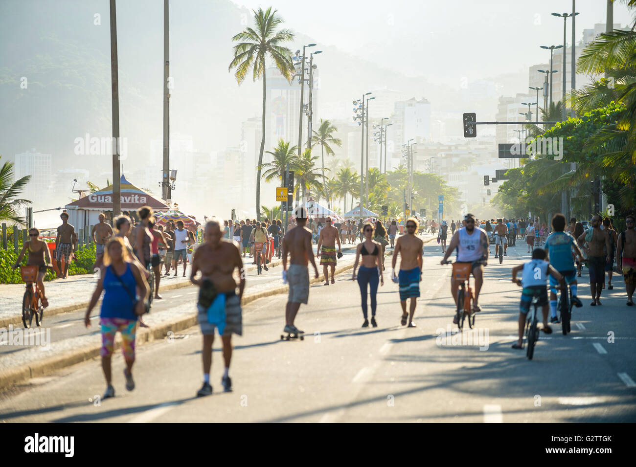 RIO DE JANEIRO - MARCH 6, 2016: Pedestrians share the car-free beachfront Avenida Vieira Souto street with skaters - Stock Image