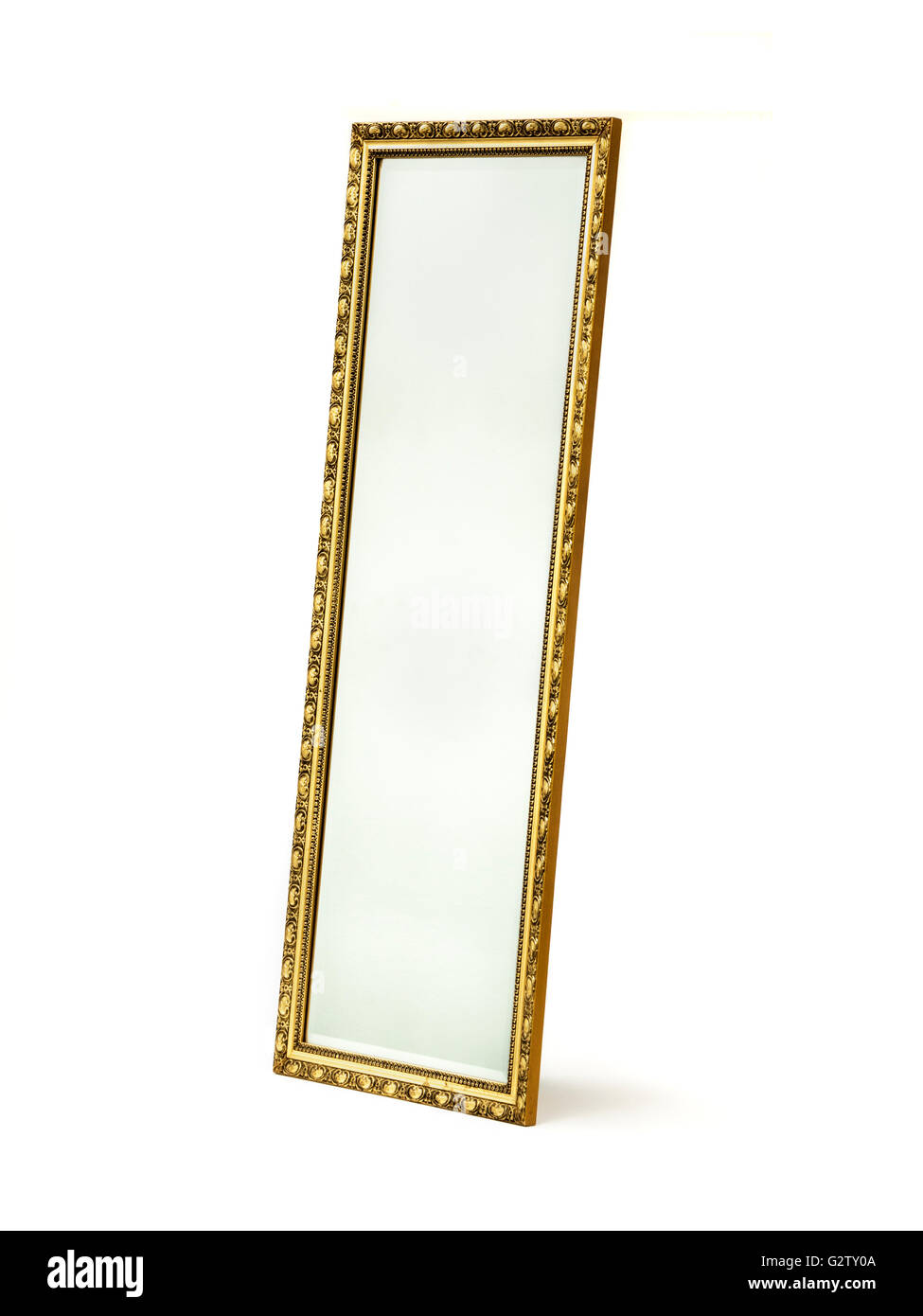 Bevelled glass mirror in gilded wooden frame - Stock Image